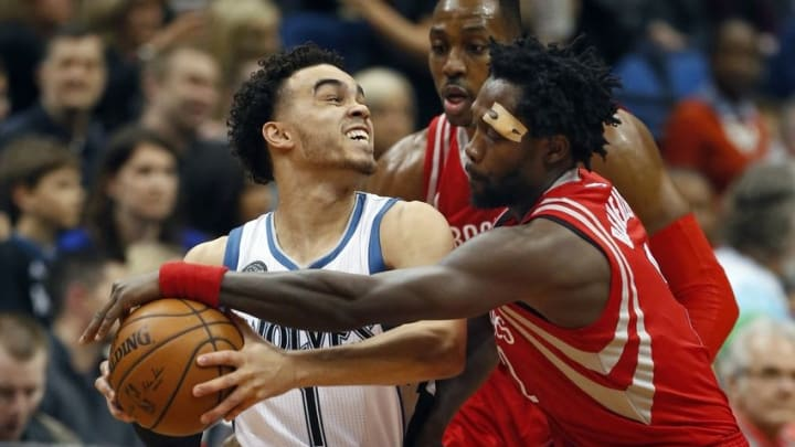 Apr 11, 2016; Minneapolis, MN, USA; Houston Rockets guard Patrick Beverley (2) tries to wrestle the ball away from Minnesota Timberwolves guard Tyus Jones (1) in the second quarter at Target Center. Mandatory Credit: Bruce Kluckhohn-USA TODAY Sports