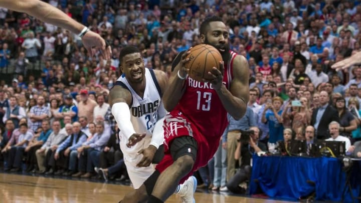 Apr 6, 2016; Dallas, TX, USA; Houston Rockets guard James Harden (13) drives to the basket past Dallas Mavericks guard Wesley Matthews (23) during the second half at the American Airlines Center. The Mavericks defeat the Rockets 88-86. Mandatory Credit: Jerome Miron-USA TODAY Sports