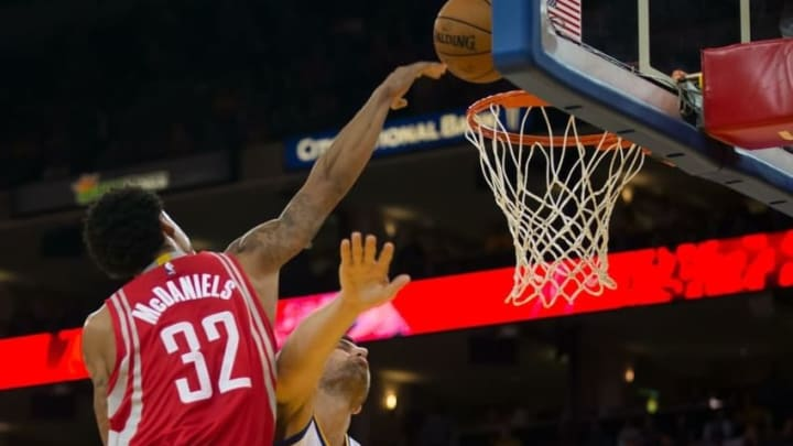 Oct 15, 2015; Oakland, CA, USA; Houston Rockets guard K.J. McDaniels (32) dunks the ball against Golden State Warriors center Andrew Bogut (12) during the second quarter at Oracle Arena. Mandatory Credit: Kelley L Cox-USA TODAY Sports