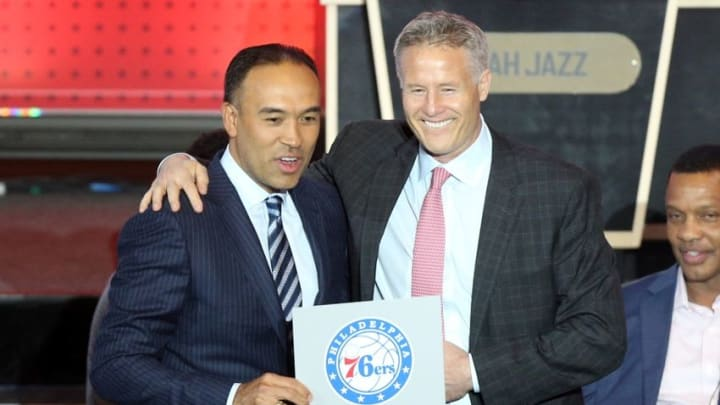 May 17, 2016; New York, NY, USA; Philadelphia 76ers head coach Brett Brown (right) poses with NBA deputy commissioner Mark Tatum after the 76ers receive the first pick in the 2016 NBA draft during the NBA draft lottery at New York Hilton Midtown. Mandatory Credit: Brad Penner-USA TODAY Sports