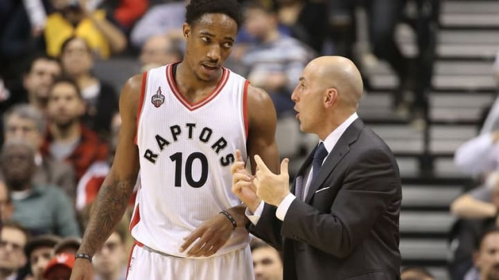 Dec 7, 2015; Toronto, Ontario, CAN; Toronto Raptors guard DeMar DeRozan (10) listens to assistant coach Rex Kalamian against the Los Angeles Lakers at Air Canada Centre. The Raptors beat the Lakers 102-93. Mandatory Credit: Tom Szczerbowski-USA TODAY Sports
