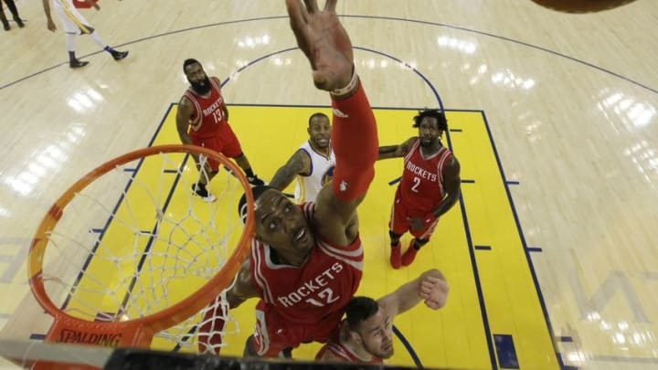 Apr 27, 2016; Oakland, CA, USA; Houston Rockets center Dwight Howard (12) rebounds against the Golden State Warriors during game five of the first round of the NBA Playoffs against the Houston Rockets at Oracle Arena. The Golden State Warriors defeated the Houston Rockets 114-81. Mandatory Credit: Marcio Jose Sanchez/Pool Photo via USA TODAYSports
