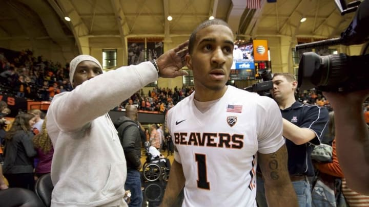 Jan 9, 2016; Corvallis, OR, USA; Oregon State Beavers guard Gary Payton II (1) celebrates with his father and former NBA star Gary Payton after the game against the California Golden Bears at Gill Coliseum. The Beavers won 77-71. Mandatory Credit: Troy Wayrynen-USA TODAY Sports