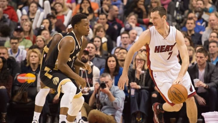 Mar 12, 2016; Toronto, Ontario, CAN; Miami Heat guard Goran Dragic (7) looks to play a ball as Toronto Raptors guard Kyle Lowry (7) tries to defend during the fourth quarter in a game at Air Canada Centre. The Toronto Raptors won 112-104. Mandatory Credit: Nick Turchiaro-USA TODAY Sports