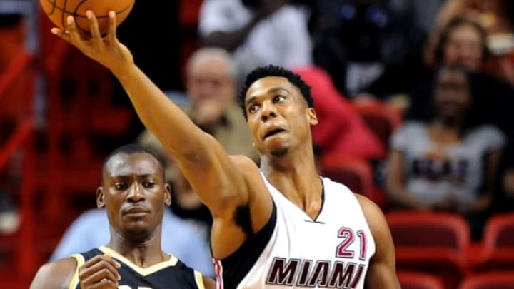 Dec 18, 2015; Miami, FL, USA; Miami Heat center Hassan Whiteside (21) reaches for the ball against Toronto Raptors center Bismack Biyombo (8) at American Airlines Arena. Mandatory Credit: Robert Duyos-USA TODAY Sports