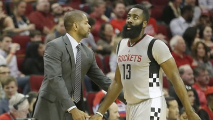 Mar 2, 2016; Houston, TX, USA; Houston Rockets head coach J.B. Bickerstaff low fives guard James Harden (13) as Harden goes to the bench against the New Orleans Pelicans in the second quarter at Toyota Center. Mandatory Credit: Thomas B. Shea-USA TODAY Sports