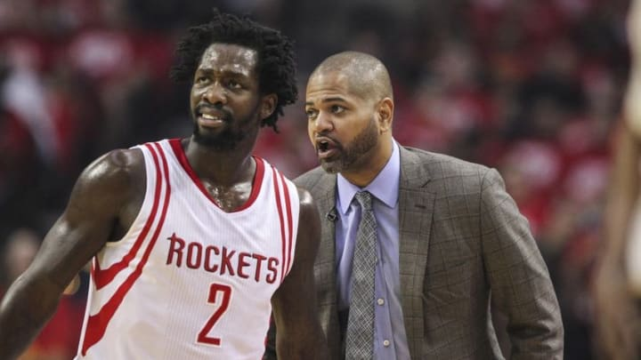 Apr 21, 2016; Houston, TX, USA; Houston Rockets head coach J.B. Bickerstaff talks with guard Patrick Beverley (2) during the first quarter against the Golden State Warriors in game three of the first round of the NBA Playoffs at Toyota Center. Mandatory Credit: Troy Taormina-USA TODAY Sports