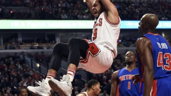 Dec 18, 2015; Chicago, IL, USA; Chicago Bulls center Joakim Noah (13) dunks against the Detroit Pistons during the first half at the United Center. Mandatory Credit: David Banks-USA TODAY Sports