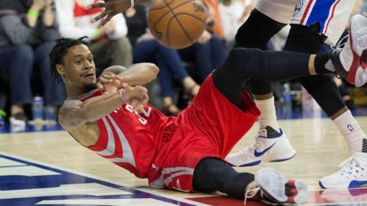 Mar 9, 2016; Philadelphia, PA, USA; Houston Rockets guard K.J. McDaniels (32) passes the ball against the Philadelphia 76ers during the second quarter at Wells Fargo Center. Mandatory Credit: Bill Streicher-USA TODAY Sports