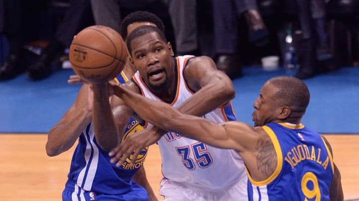 May 24, 2016; Oklahoma City, OK, USA; Oklahoma City Thunder forward Kevin Durant (35) passes as Golden State Warriors forward Andre Iguodala (9) defends during the second quarter in game four of the Western conference finals of the NBA Playoffs at Chesapeake Energy Arena. Mandatory Credit: Mark D. Smith-USA TODAY Sports