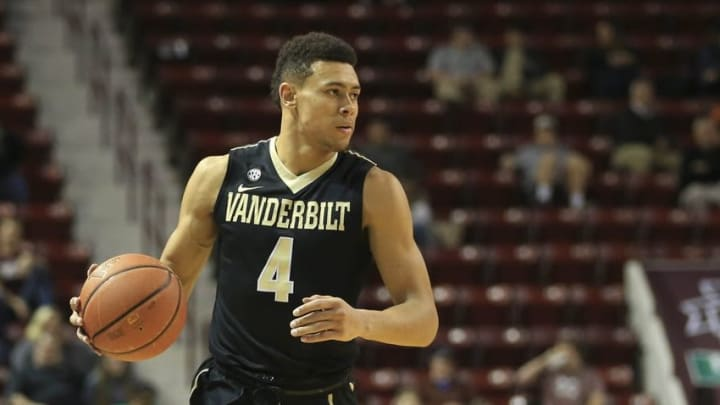 Feb 16, 2016; Starkville, MS, USA; Vanderbilt Commodores guard Wade Baldwin IV (4) brings the ball up court during the first half against the Mississippi State Bulldogs at Humphrey Coliseum. Mandatory Credit: Spruce Derden-USA TODAY Sports