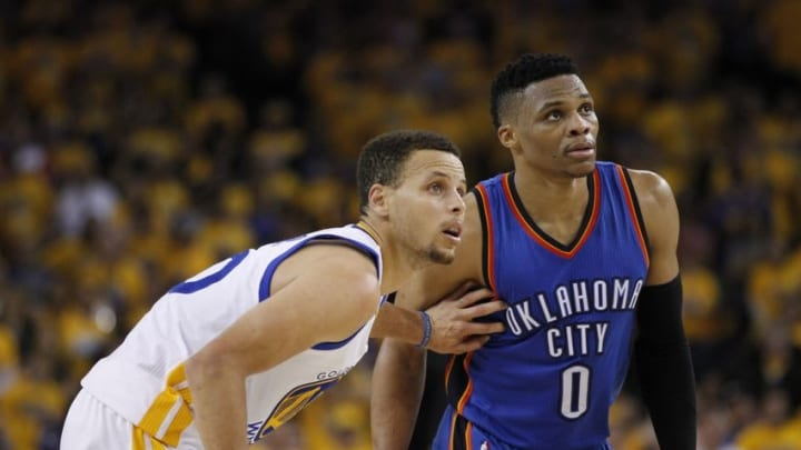 May 26, 2016; Oakland, CA, USA; Oklahoma City Thunder guard Russell Westbrook (0) is defended by Golden State Warriors guard Stephen Curry (30) in the fourth quarter in game five of the Western conference finals of the NBA Playoffs at Oracle Arena. The Warriors won 120-111. Mandatory Credit: Cary Edmondson-USA TODAY Sports