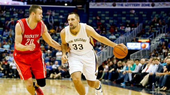 Oct 14, 2014; New Orleans, LA, USA; New Orleans Pelicans forward Ryan Anderson (33) dribbles the ball around Houston Rockets forward Donatas Motiejunas (20) during the first quarter at the Smoothie King Center. Mandatory Credit: Derick E. Hingle-USA TODAY Sports