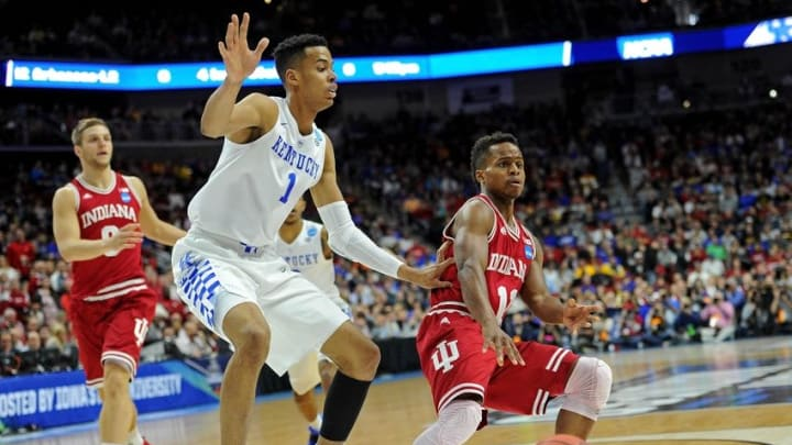 Mar 19, 2016; Des Moines, IA, USA; Indiana Hoosiers guard Yogi Ferrell (11) passes the ball against Kentucky Wildcats forward Skal Labissiere (1) in the first half during the second round of the 2016 NCAA Tournament at Wells Fargo Arena. Mandatory Credit: Steven Branscombe-USA TODAY Sports