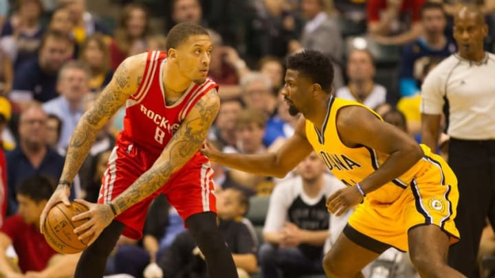Mar 27, 2016; Indianapolis, IN, USA; Houston Rockets forward Michael Beasley (8) looks to dribble the ball while Indiana Pacers forward Solomon Hill (44) defends in the first half of the game at Bankers Life Fieldhouse. Mandatory Credit: Trevor Ruszkowski-USA TODAY Sports