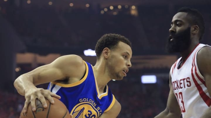 May 25, 2015; Houston, TX, USA; Golden State Warriors guard Stephen Curry (30) looks to drive as Houston Rockets guard James Harden (13) defends during the first quarter in game four of the Western Conference Finals of the NBA Playoffs. at Toyota Center. Mandatory Credit: Thomas B. Shea-USA TODAY Sports