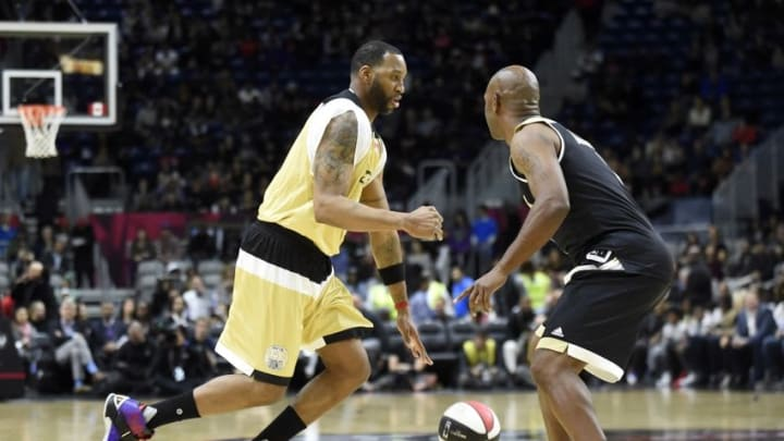 Feb 12, 2016; Toronto, Ontario, Canada; Canada player Tracy McGrady (left) dribbles the ball against USA player Chauncey Billups (right) during the All-Star celebrity basketball game at Ricoh Coliseum. Mandatory Credit: Peter Llewellyn-USA TODAY Sports