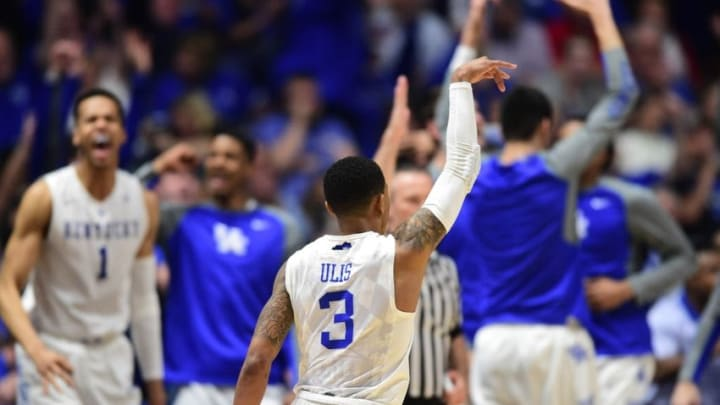 Mar 11, 2016; Nashville, TN, USA; Kentucky Wildcats guard Tyler Ulis (3) celebrates after a three-pointer as teammates on the bench cheer in the second half against the Alabama Crimson Tide during the SEC tournament at Bridgestone Arena. Kentucky won 85-59. Mandatory Credit: Christopher Hanewinckel-USA TODAY Sports