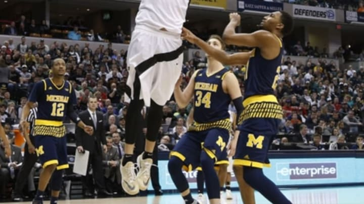 Mar 12, 2016; Indianapolis, IN, USA; Purdue Boilermakers center A.J. Hammons (20) dunks against Michigan Wolverines forward Mark Donnal (34) during the Big Ten Conference tournament at Bankers Life Fieldhouse. Purdue defeats Michigan 76-59. Mandatory Credit: Brian Spurlock-USA TODAY Sports