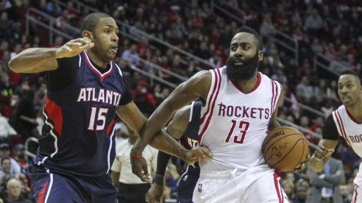 Dec 20, 2014; Houston, TX, USA; Houston Rockets guard James Harden (13) drives the ball to the basket during the fourth quarter as Atlanta Hawks center Al Horford (15) defends at Toyota Center. The Hawks defeated the Rockets 104-97. Mandatory Credit: Troy Taormina-USA TODAY Sports