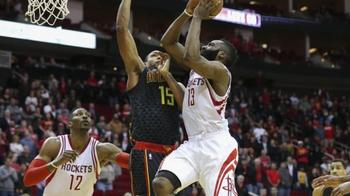Dec 29, 2015; Houston, TX, USA; Houston Rockets guard James Harden (13) moves the ball as Atlanta Hawks center Al Horford (15) defends during the fourth quarter at Toyota Center. The Hawks defeated the Rockets 121-115. Mandatory Credit: Troy Taormina-USA TODAY Sports