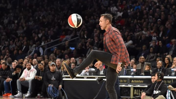 Feb 13, 2016; Toronto, Ontario, Canada; Steve Nash kicks a basketball as he assists Detroit Pistons center Andre Drummond (not pictured) in the dunk contest the NBA All Star Saturday Night at Air Canada Centre. Mandatory Credit: Bob Donnan-USA TODAY Sports