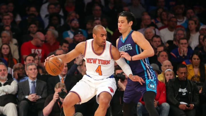 Apr 6, 2016; New York, NY, USA; New York Knicks shooting guard Arron Afflalo (4) drives against Charlotte Hornets point guard Jeremy Lin (7) during the first quarter at Madison Square Garden. Mandatory Credit: Brad Penner-USA TODAY Sports