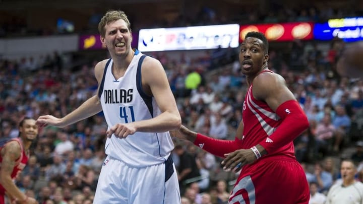 Apr 6, 2016; Dallas, TX, USA; Dallas Mavericks forward Dirk Nowitzki (41) reacts to a call as Houston Rockets center Dwight Howard (12) looks on during the second half at the American Airlines Center. The Mavericks defeat the Rockets 88-86. Mandatory Credit: Jerome Miron-USA TODAY Sports
