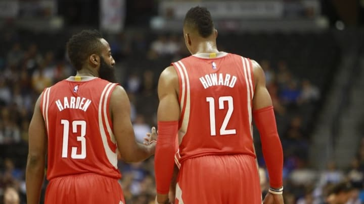 Dec 17, 2014; Denver, CO, USA; Houston Rockets center Dwight Howard (right) and guard James Harden (left) talk during the first half against the Denver Nuggets at Pepsi Center. Mandatory Credit: Chris Humphreys-USA TODAY Sports