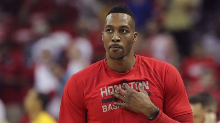Apr 21, 2016; Houston, TX, USA; Houston Rockets center Dwight Howard (12) attempts a free throw during the fourth quarter against the Golden State Warriors in game three of the first round of the NBA Playoffs at Toyota Center. The Rockets won 97-96. Mandatory Credit: Troy Taormina-USA TODAY Sports