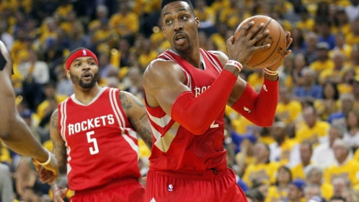 Apr 18, 2016; Oakland, CA, USA; Houston Rockets center Dwight Howard (12) holds onto a rebound against the Golden State Warriors in the fourth quarter in game two of the first round of the NBA Playoffs at Oracle Arena. The Warriors defeated the Rockets 115-106. Mandatory Credit: Cary Edmondson-USA TODAY Sports