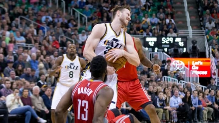 Feb 23, 2016; Salt Lake City, UT, USA; Utah Jazz forward Gordon Hayward (20) reacts to being fouled by Houston Rockets guard James Harden (13) during the second half at Vivint Smart Home Arena. Utah won in overtime 117-114. Mandatory Credit: Russ Isabella-USA TODAY Sports