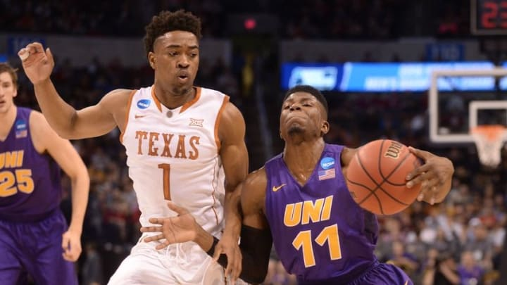 Mar 18, 2016; Oklahoma City, OK, USA; Northern Iowa Panthers guard Wes Washpun (11) drives against Texas Longhorns guard Isaiah Taylor (1) in the first half during the first round of the 2016 NCAA Tournament at Chesapeake Energy Arena. Mandatory Credit: Mark D. Smith-USA TODAY Sports
