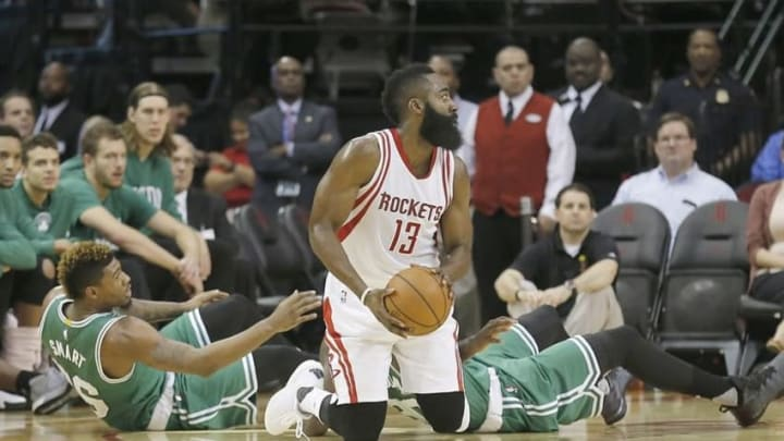 Nov 16, 2015; Houston, TX, USA; Houston Rockets guard James Harden (13) looks for a pass against the Boston Celtics in the first quarter at Toyota Center. Mandatory Credit: Thomas B. Shea-USA TODAY Sports
