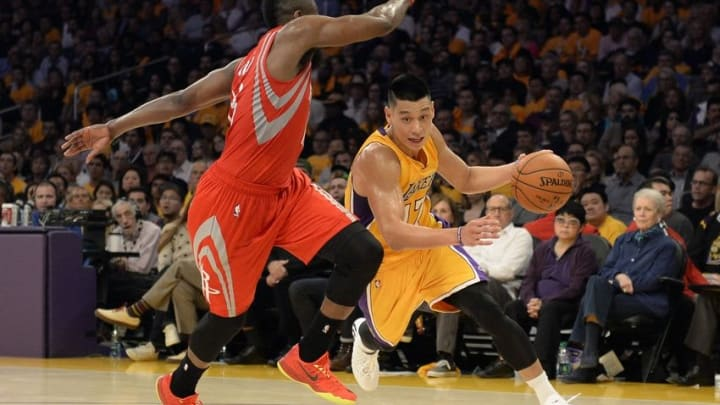 Oct 28, 2014; Los Angeles, CA, USA; Los Angeles Lakers guard Jeremy Lin (17) drives against Houston Rockets guard James Harden (13) during the second half at Staples Center. Mandatory Credit: Richard Mackson-USA TODAY Sports