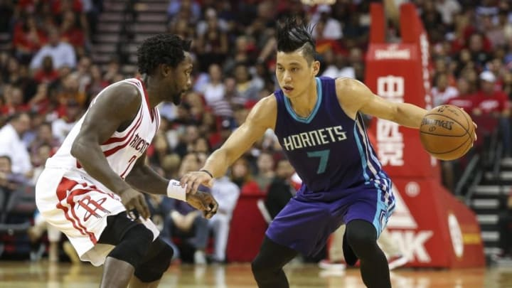 Dec 21, 2015; Houston, TX, USA; Charlotte Hornets guard Jeremy Lin (7) drives the ball during the fourth quarter as Houston Rockets guard Patrick Beverley (2) defends at Toyota Center. The Rockets defeated the Hornets 102-95. Mandatory Credit: Troy Taormina-USA TODAY Sports