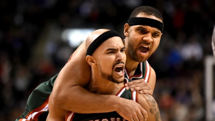 Feb 2, 2015; Toronto, Ontario, CAN; Milwaukee Bucks guard Jerryd Bayless (19) celebrates with forward Jared Dudley (9) in the fourth quarter at Air Canada Centre. The Bucks won 82-75. Mandatory Credit: Dan Hamilton-USA TODAY Sports