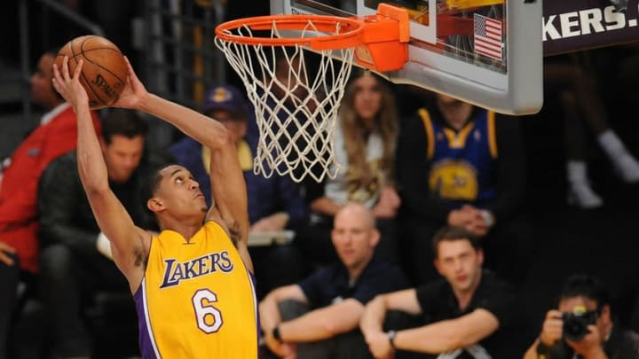 April 13, 2016; Los Angeles, CA, USA; Los Angeles Lakers guard Jordan Clarkson (6) dunks to score a basket against Utah Jazz during the second half at Staples Center. Mandatory Credit: Gary A. Vasquez-USA TODAY Sports