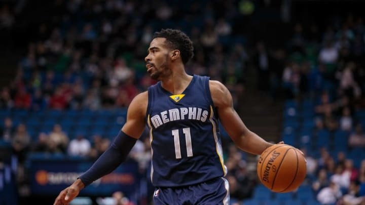 Nov 15, 2015; Minneapolis, MN, USA; Memphis Grizzlies guard Mike Conley (11) dribbles in the first quarter against the Minnesota Timberwolves at Target Center. Mandatory Credit: Brad Rempel-USA TODAY Sports