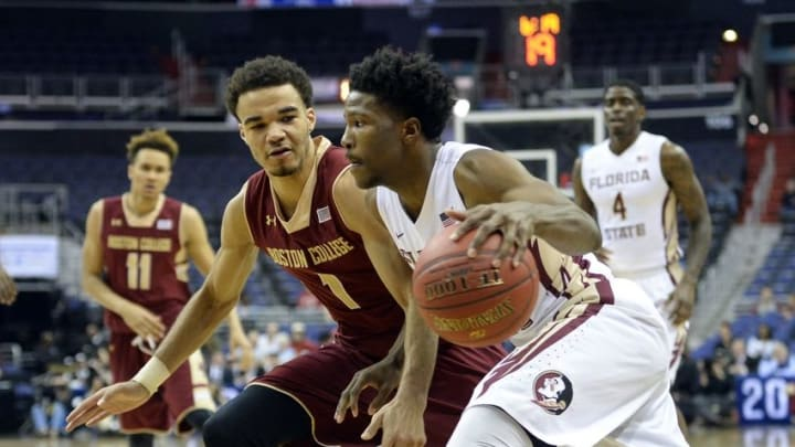 Mar 8, 2016; Washington, DC, USA; Florida State Seminoles guard Malik Beasley (5) drives as Boston College Eagles guard Jerome Robinson (1) defends in the second half during round one of the ACC tournament at Verizon Center. Florida State Seminoles defeated Boston College Eagles 88-66. Mandatory Credit: Tommy Gilligan-USA TODAY Sports