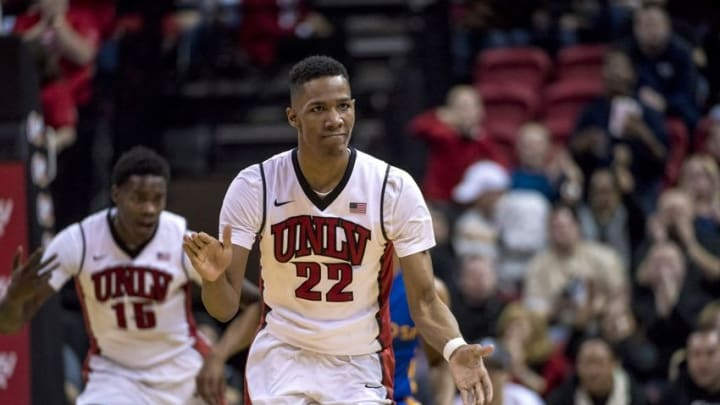 Feb 10, 2016; Las Vegas, NV, USA; UNLV Rebels guard Patrick McCaw (22) reacts after making a three point shot against the San Jose State Spartans during the second half at Thomas & Mack Center. UNLV won 64-61. Mandatory Credit: Joshua Dahl-USA TODAY Sports