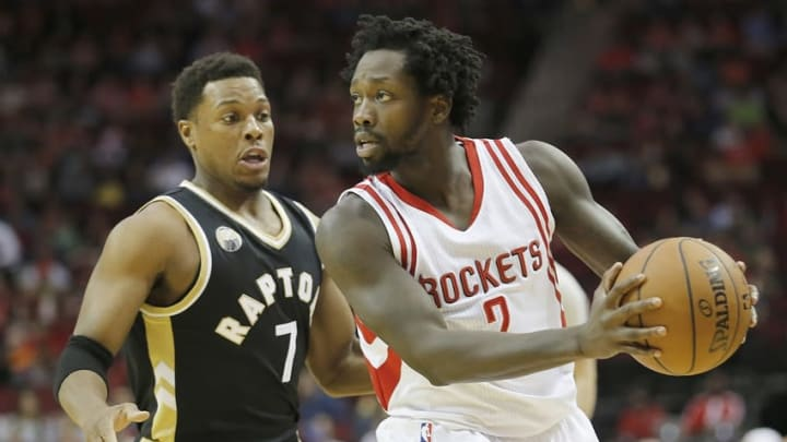 Mar 25, 2016; Houston, TX, USA; Houston Rockets guard Patrick Beverley (2) controls the ball as Toronto Raptors guard Kyle Lowry (7) defends in the first quarter at Toyota Center. Mandatory Credit: Thomas B. Shea-USA TODAY Sports