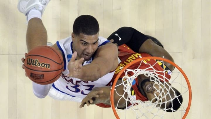 Mar 24, 2016; Louisville, KY, USA; Kansas Jayhawks forward Landen Lucas (33) shoots the ball against Maryland Terrapins forward Robert Carter (4) during the first half in a semifinal game in the South regional of the NCAA Tournament at KFC YUM!. Mandatory Credit: Jamie Rhodes-USA TODAY Sports