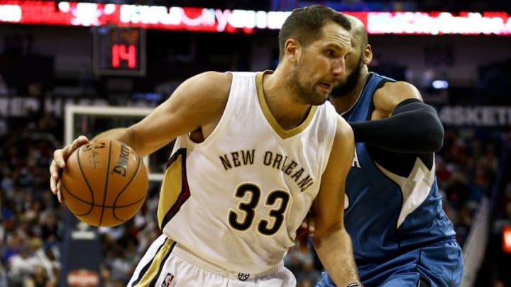 Feb 27, 2016; New Orleans, LA, USA; New Orleans Pelicans forward Ryan Anderson (33) moves past Minnesota Timberwolves forward Adreian Payne (33) during the second half of a game at the Smoothie King Center. The Timberwolves defeated the Pelicans 112-110. Mandatory Credit: Derick E. Hingle-USA TODAY Sports