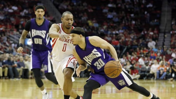 Apr 13, 2016; Houston, TX, USA; Sacramento Kings guard Seth Curry (30) dribbles against Houston Rockets guard Andrew Goudelock (0) in the second half at Toyota Center. Rockets won 116 to 81. Mandatory Credit: Thomas B. Shea-USA TODAY Sports