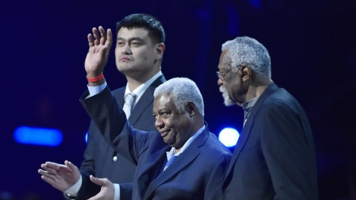 Feb 14, 2016; Toronto, Ontario, CAN; NBA former players from left Yao Ming , Oscar Robertson and Bill Russell are honored during a timeout in the first half of the NBA All Star Game at Air Canada Centre. Mandatory Credit: Bob Donnan-USA TODAY Sports