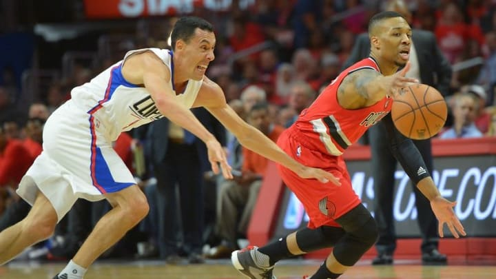 Apr 27, 2016; Los Angeles, CA, USA; Los Angeles Clippers guard Pablo Prigioni (9) guards Portland Trail Blazers guard Damian Lillard (0) in the first half of game five of the first round of the NBA Playoffs at Staples Center. Mandatory Credit: Jayne Kamin-Oncea-USA TODAY Sports