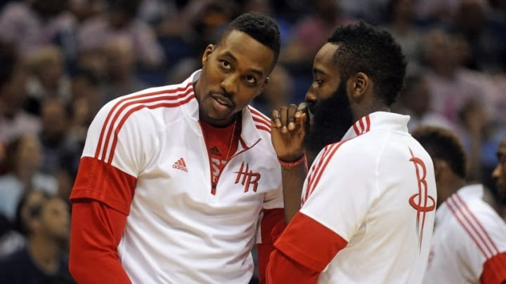 Oct 22, 2014; Orlando, FL, USA; Houston Rockets center Dwight Howard, left, talks with guard James Harden during a timeout as the Rockets beat the Orlando Magic 90-89 at Amway Center. Mandatory Credit: David Manning-USA TODAY Sports