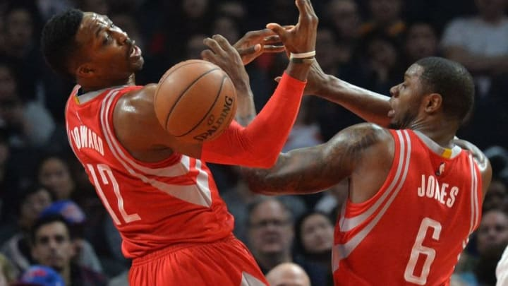 Jan 18, 2016; Los Angeles, CA, USA; Houston Rockets center Dwight Howard (12) and forward Terrence Jones (6) battle for a rebound during an NBA basketball game against the Los Angeles Clippers at Staples Center. Mandatory Credit: Kirby Lee-USA TODAY Sports