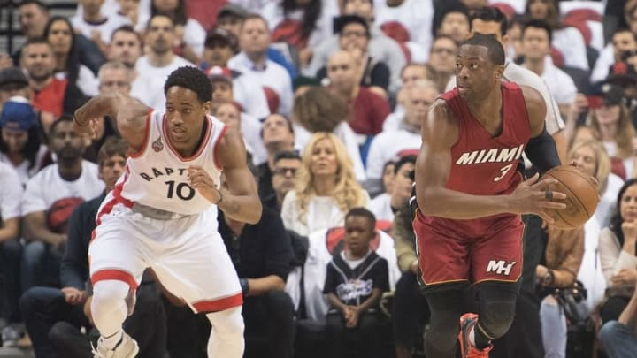 May 15, 2016; Toronto, Ontario, CAN; Miami Heat guard Dwyane Wade (3) looks to play a ball as Toronto Raptors guard DeMar DeRozan (10) gives chase during the first quarter in game seven of the second round of the NBA Playoffs at Air Canada Centre. The Toronto Raptors won 116-89. Mandatory Credit: Nick Turchiaro-USA TODAY Sports